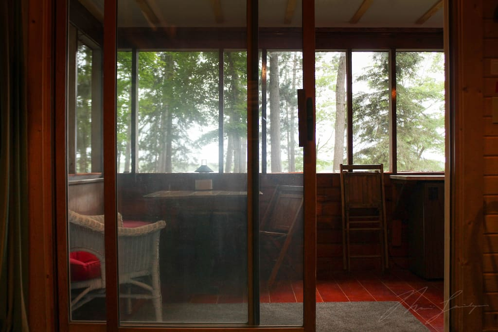 View of screen porch and lake from inside Cabin