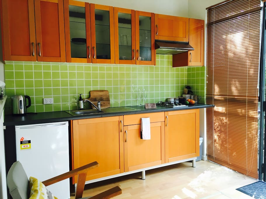 Bright and light fully functional kitchen.