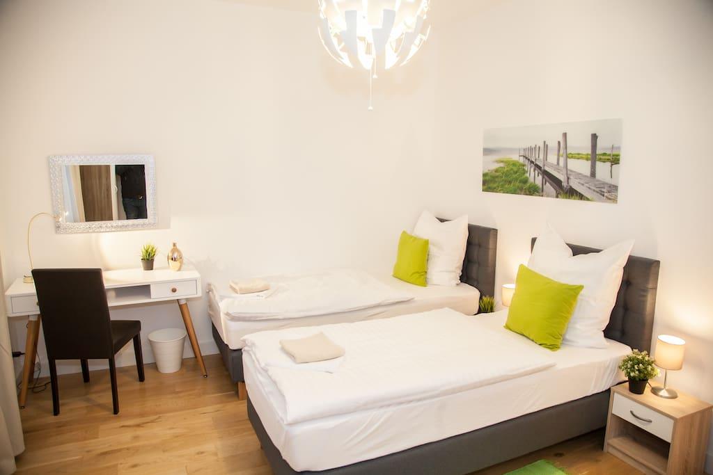 "3d bedroom, ""Green"", beds like 2 single beds."