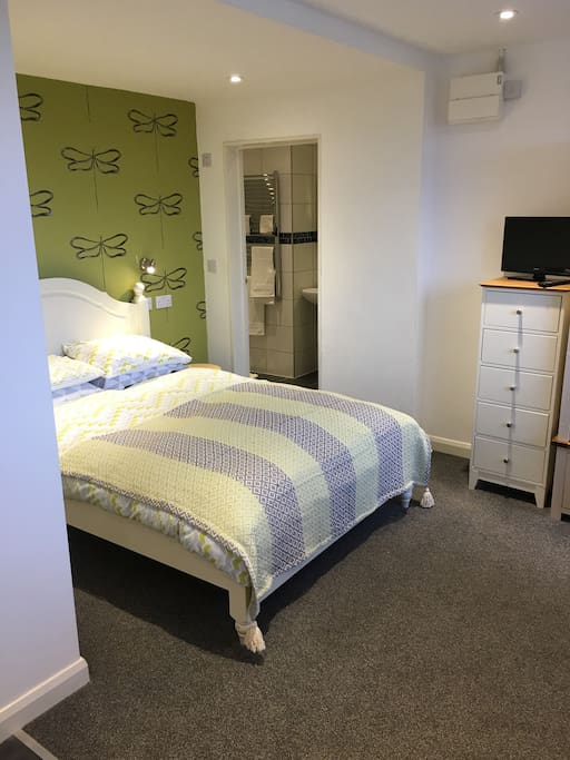 Double bed and ensuite bathroom
