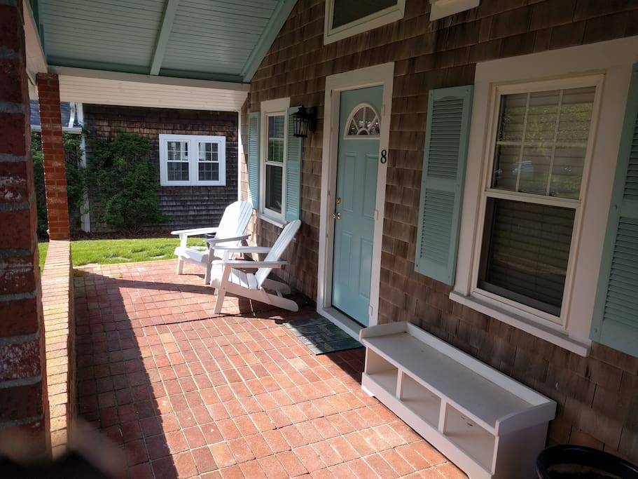 Front porch with adirondack chairs and bench