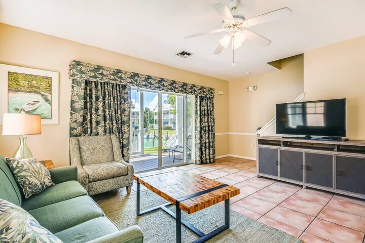 Canal-front townhome w/ boat slip, double-decker porches & great location!