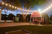 Red barn patio at night, horseshoe game