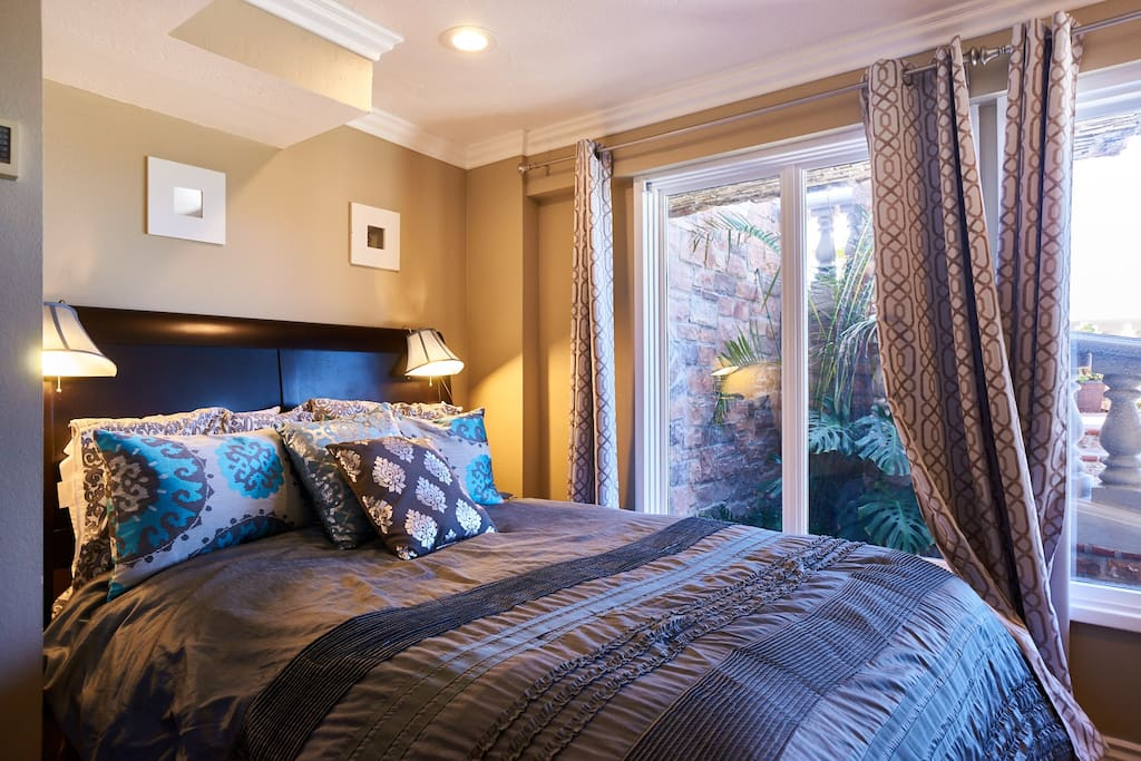 Brand-new bed and mattress set in bedroom- Full wall of windows with blackout shades