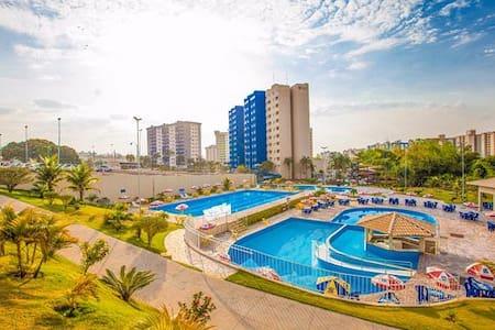 Flat no Hotel Golden Dolphin Xpress com sacada