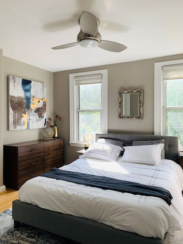 Master bedroom with comfortable queen-size bed