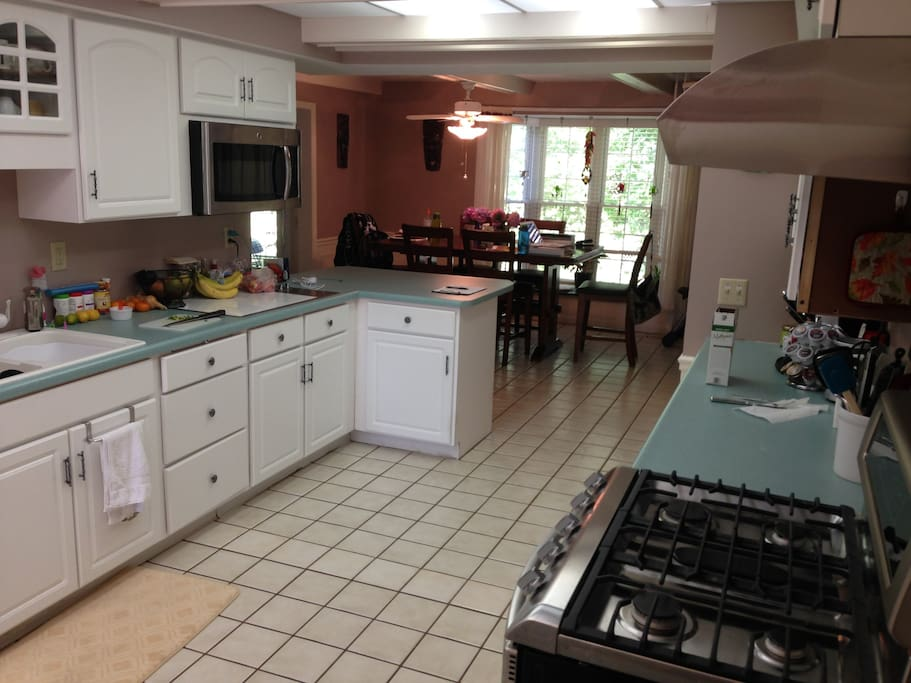 Kitchen with shared fridge and pantry space. Extra full fridge in the garage