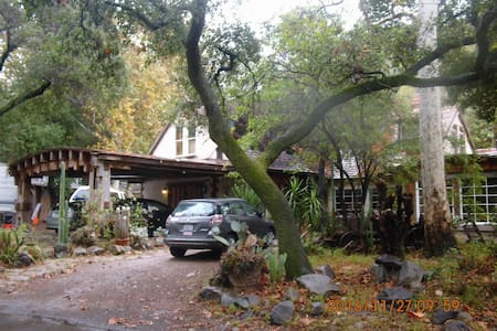 Rustic canyon home-large converted garage bedroom