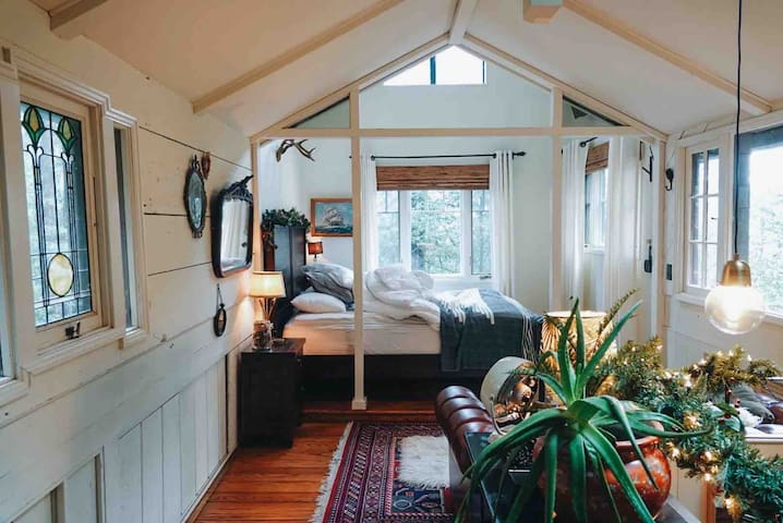 View of our loft bedroom with lounging area. Photo by Lindsey Chambers