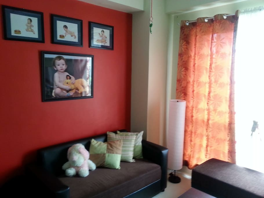 Our quiet, relaxing living room with photos of our adorable son..