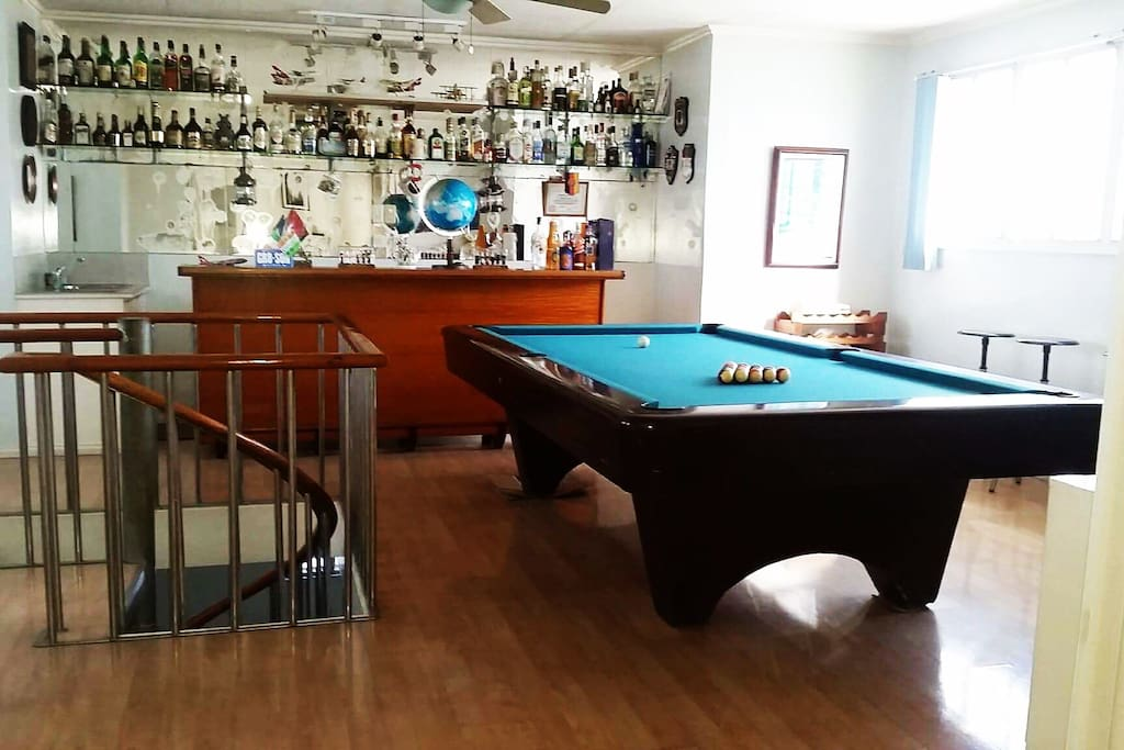 Pool table & Bar. By the stairs. We collect alcohol.