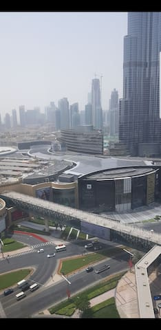VIEW from living room use he tunnel from inside the hotel to Dubai Mall walking .