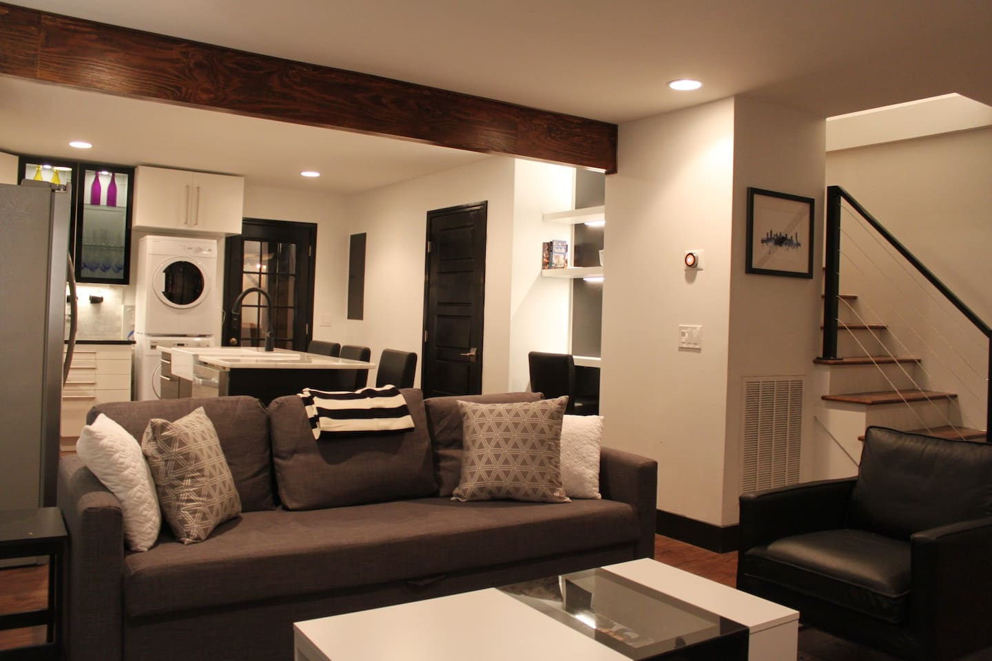 Beautiful Modern Open Concept Living Room Complete with Two Sleeper Sofas that fold out into two full sized beds!