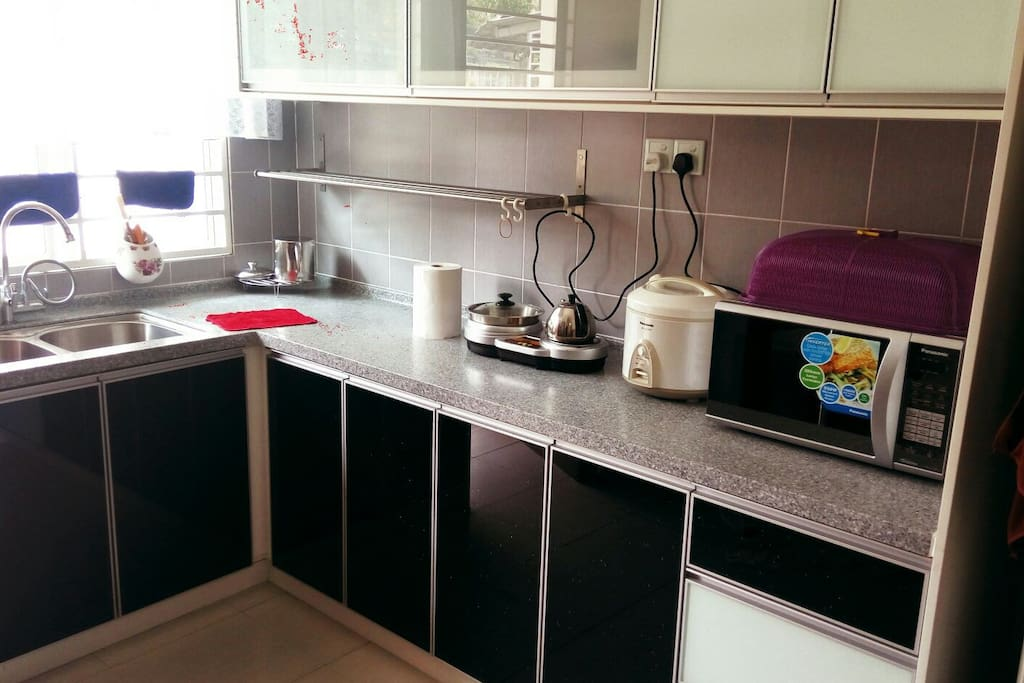 Kitchen with basic complete utensil.