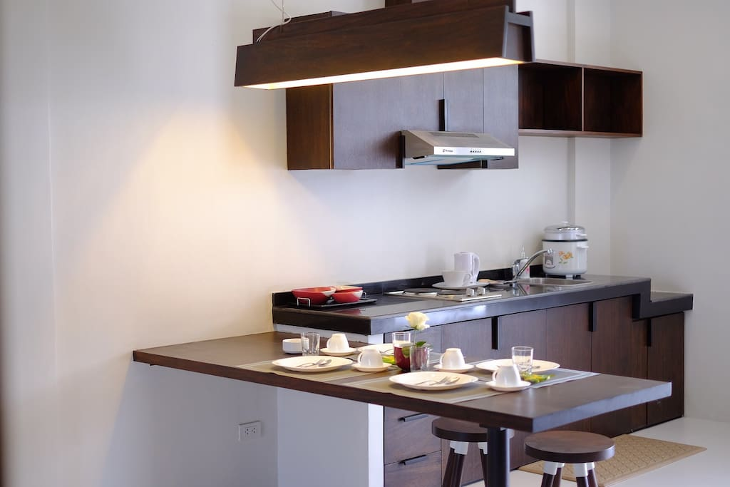 Dining and kitchen- with rangehood,cooktop, rice cooker (not in picture-- refrigerator and microwave)