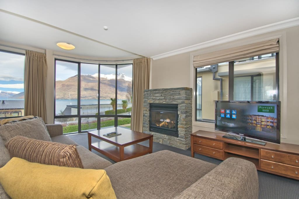 Cosy living area complete with lake and mountain views and gas fire