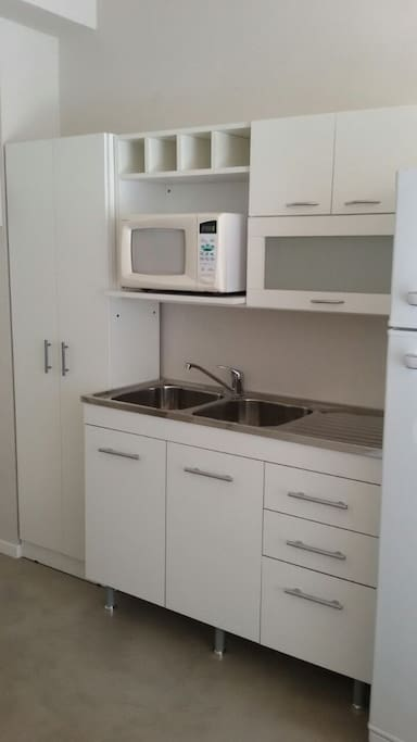 Full American Kitchen with electrical pot, coffee pot, freezer, microwave