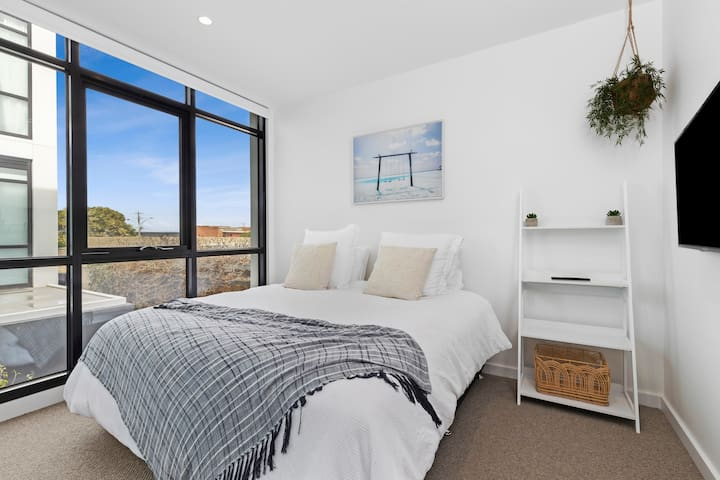The master bedroom is beautifully appointed with a King-size bed, Smart TV with Netflix connectivity and an ensuite.