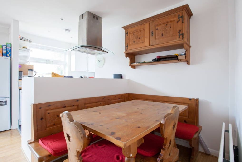 The cosy dining and breakfast area where you can dine with candles or just have a lovely breaky. The table is made out of traditional swiss wooden pine.