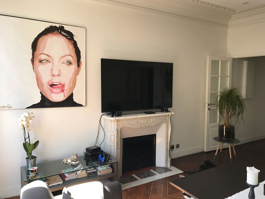 TV and painting of Angelina Jolie