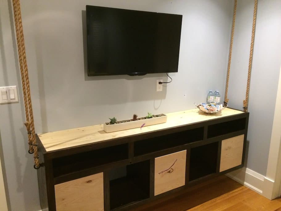 Rustic, hand made cabinet. Smart TV for your entertainment.