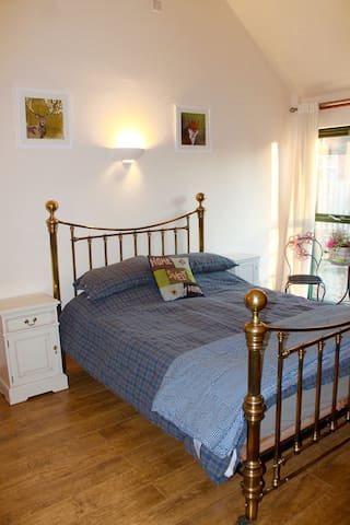 Bed room one with double bed and Ensuite bathroom
