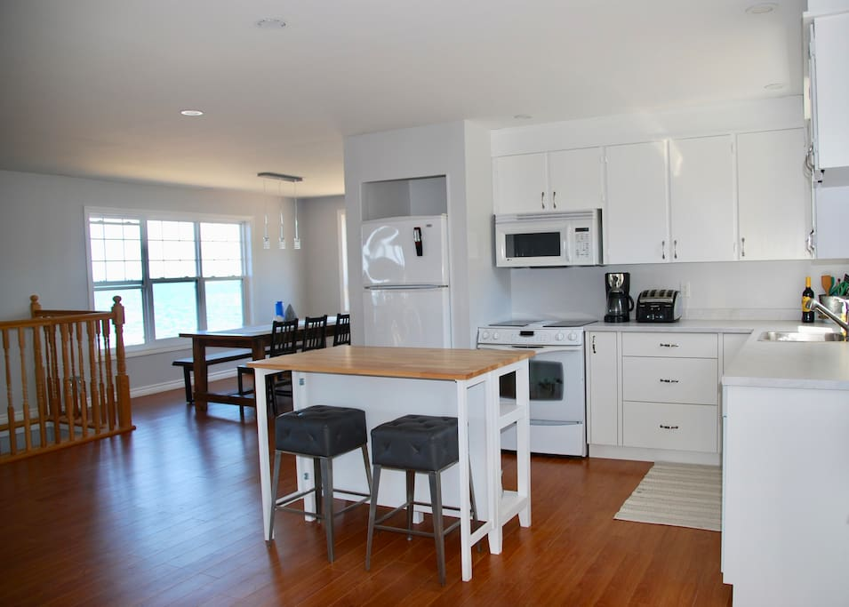 Open concept kitchen with dishwasher