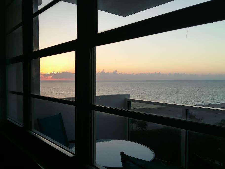 Sunrise over the ocean from inside the studio