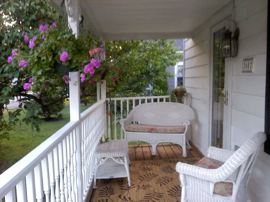 I have added furniture since this picture was taken so the front porch can comfortably accommodate 4 people .