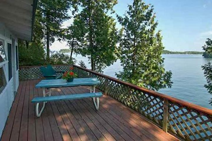Lakefront cabin w/ deck, dock access - canoes, kayaks & more provided, dogs OK!