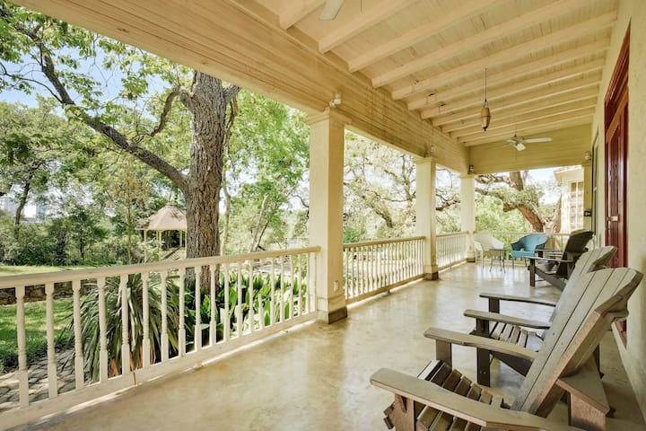 Sit back and relax on the porch dotted with chairs.
