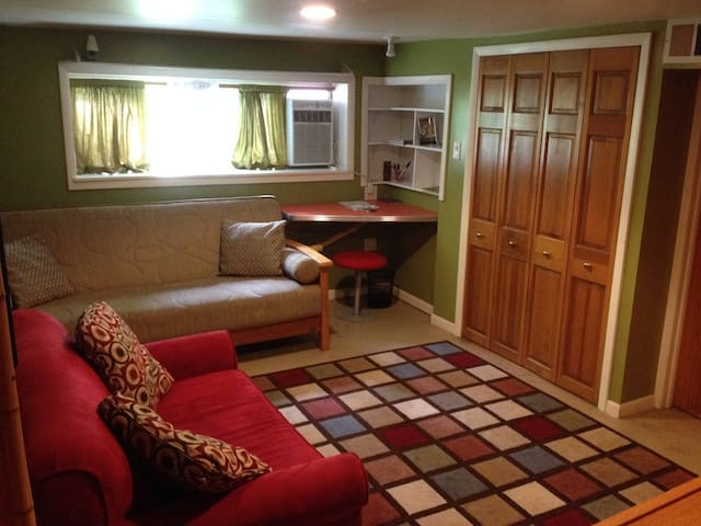 Sleeper sofa and loveseat. Closet has a fold-out cot for extra guests