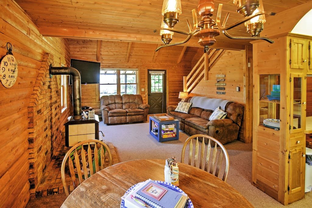 The charming log cabin offers ample space to spread out and relax.