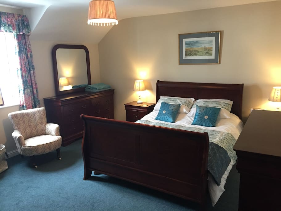 Bedroom 2. King Size bed, wardrobe, chest of drawers, TV, Large Dressing Table with drawers.
