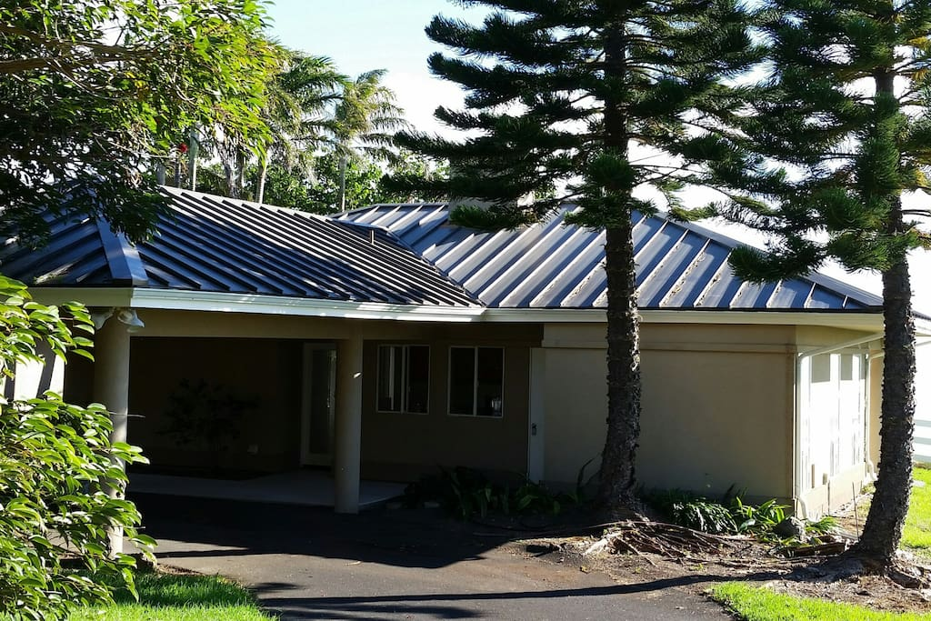 Driveway side of Ohana with covered parking