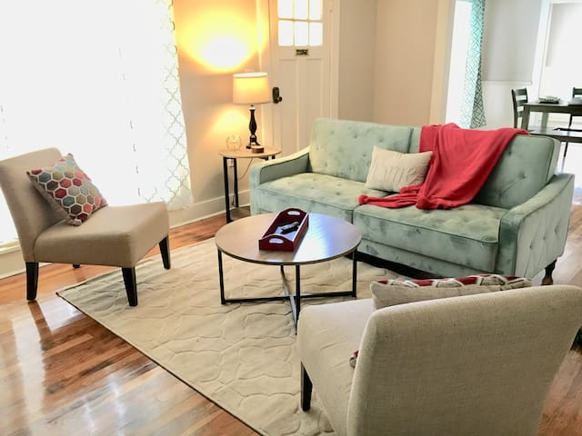 The living room is a comfortable size, with seating for 5 or 6, and the couch folds down into a full size futon style bed.