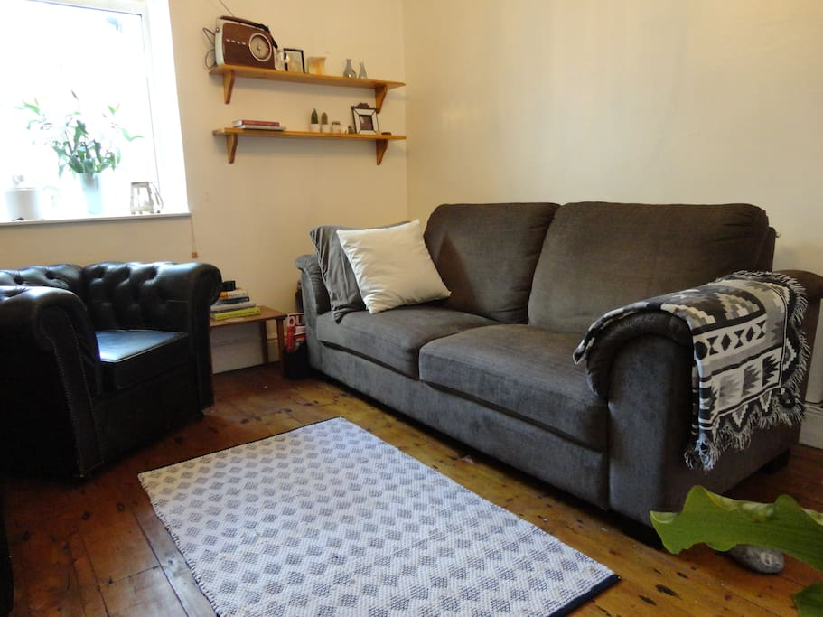 Living Room: Probably the comfiest sofa in Cardiff, lots of space to stretch out and relax after an spending time in the city.