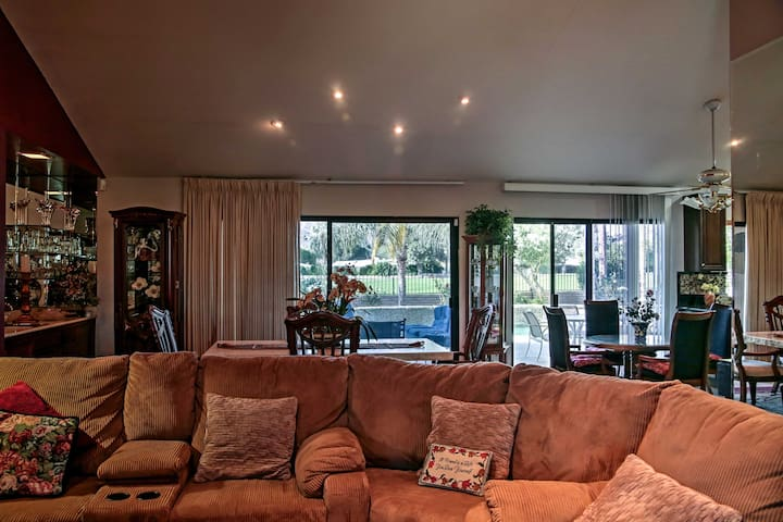 The sun shines through the sliding glass doors to illuminate the entire room!