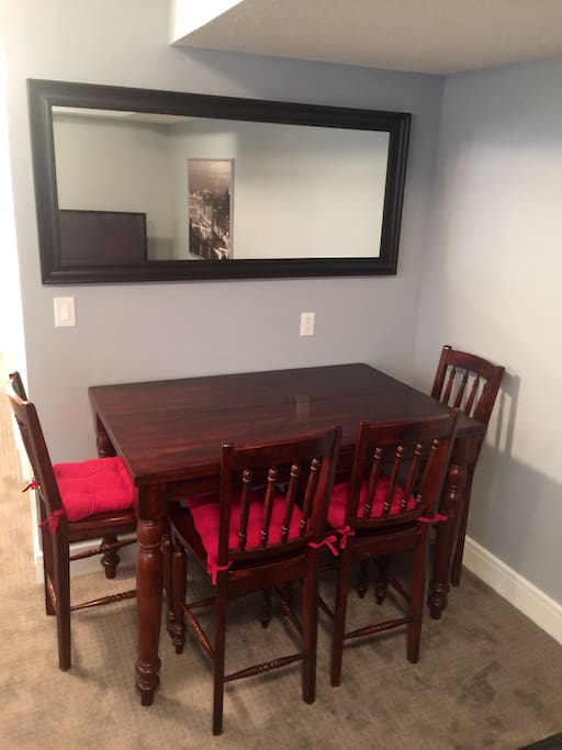 Large solid wood dining table that is perfect for enjoying a meal or working.