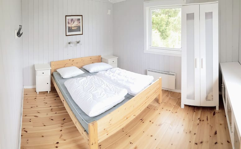 Guest house bedroom with two double bed.