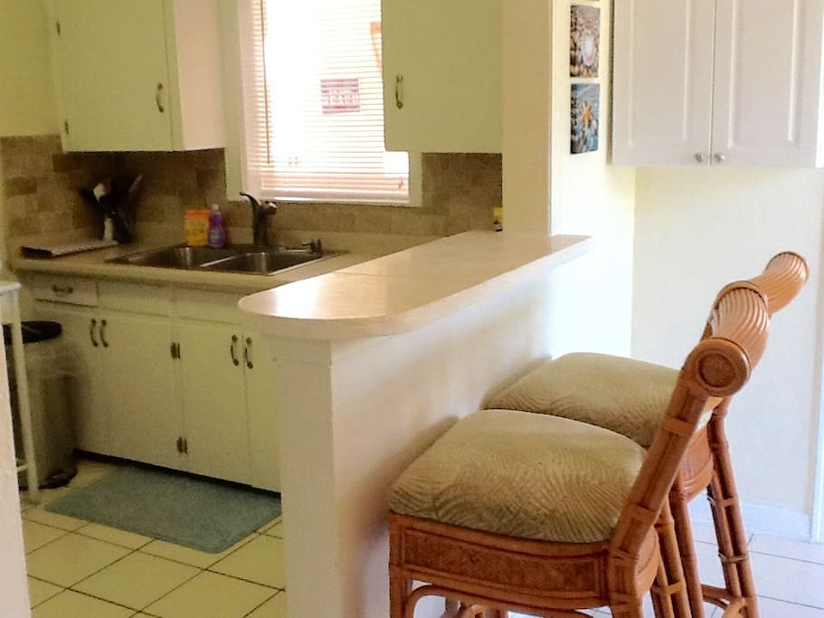 Kitchen area walk though to Florida room and dining table.