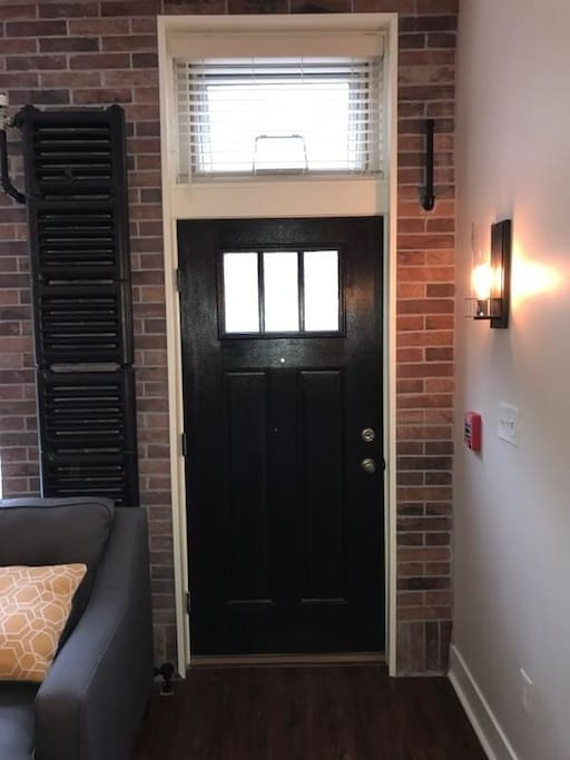 First floor private entrance to the condo exposed brick work