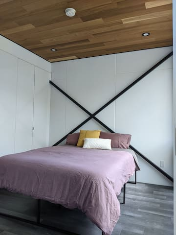 Rest and relax on the organic cotton queen sized mattress Netflix and chill with the 43 inch ultra HD wall mounted TV