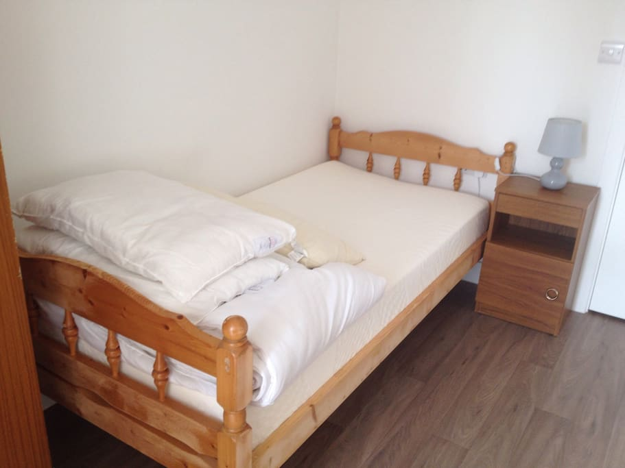 The pine bed has a memory foam mattress a double duvet and two pillows for comfort.