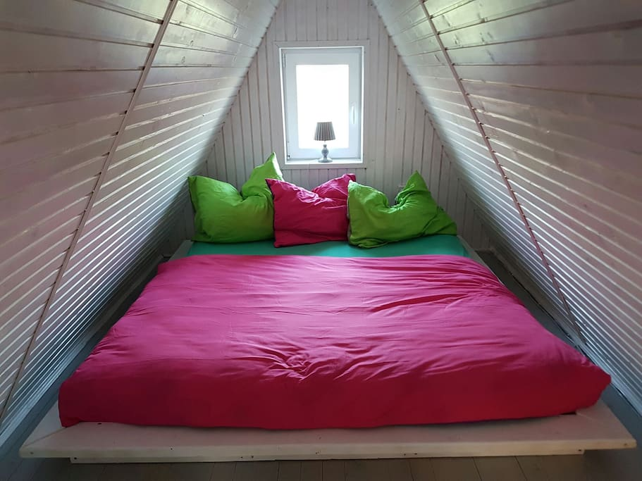 Comfortable, spacious bed in the upper room.
