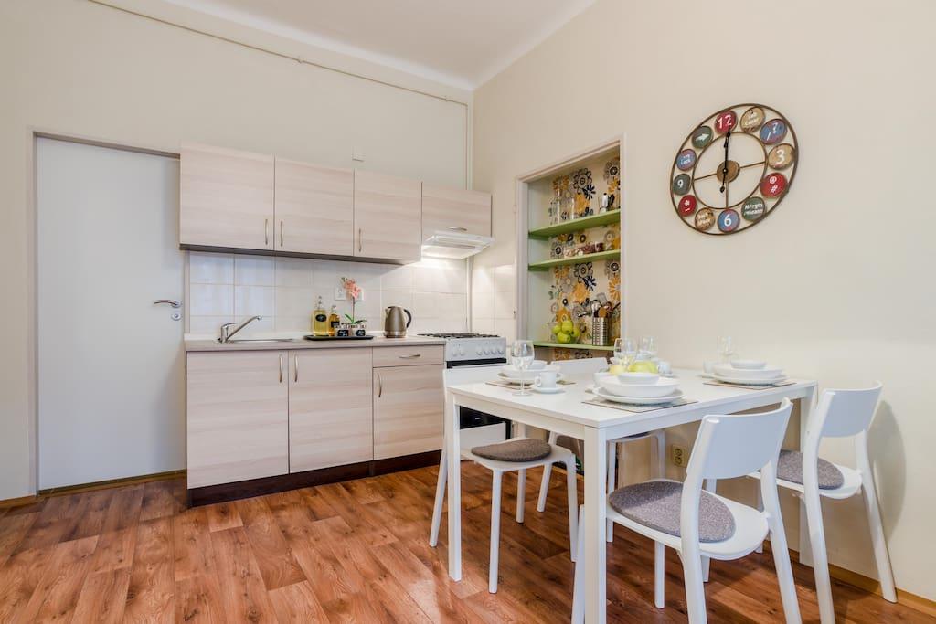 Our kitchen corner is designed in bright colors and it´s very well equipped.