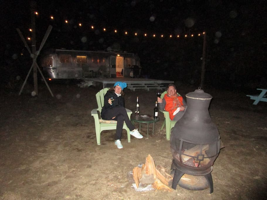 A couple of our guests from Australia enjoying the outdoor fireplace this winter.
