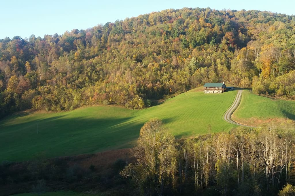 A panoramic view of cabin in the fall season.