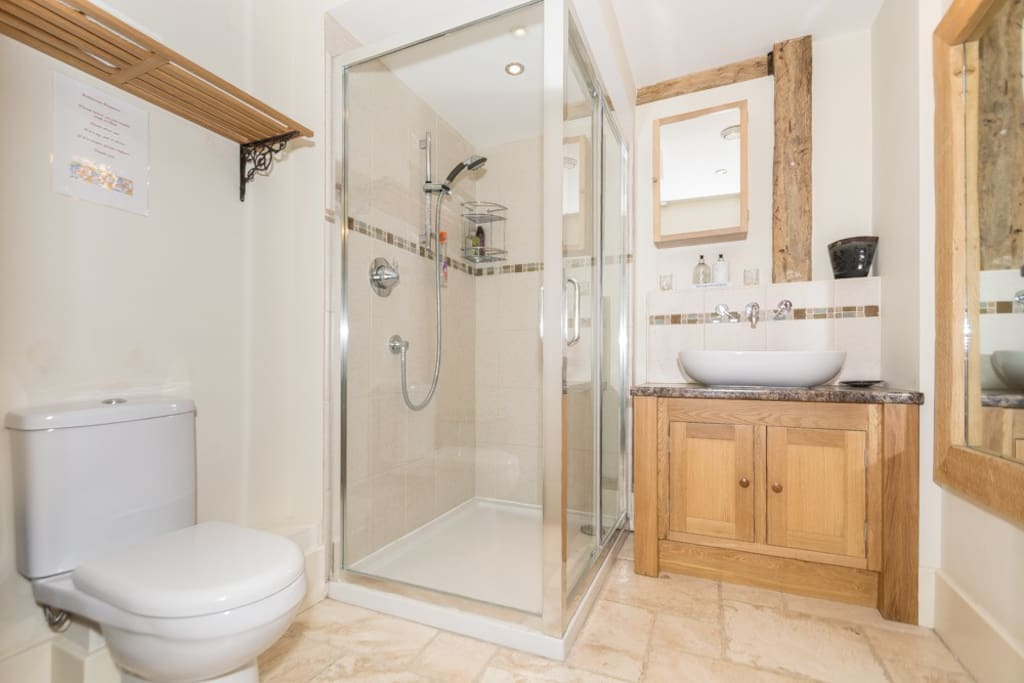 Large walk-in shower with all amenities provided.