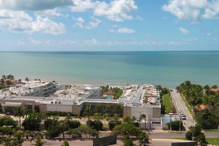 Quarto em apartamento com vista para o mar!